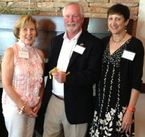 Shirley Estes, left, and Deborah Marquardt Raper, right, receive the Quintilla Medal from President Don Willis.